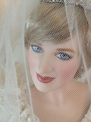 July 29, 1981: Prince Charles marries Lady Diana Spencer in Saint Paul's Cathedral. Princess Diana wedding earrings. Princess Diana (porcelain) Wedding Doll, Franklin Mint