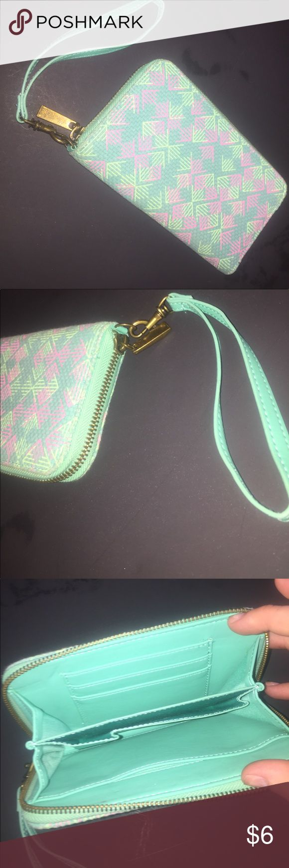 Women's wristlet Never used. From target. Cloth material. Fake leather on inside and strap. Bronze zipper. Place for phone Bags Clutches & Wristlets