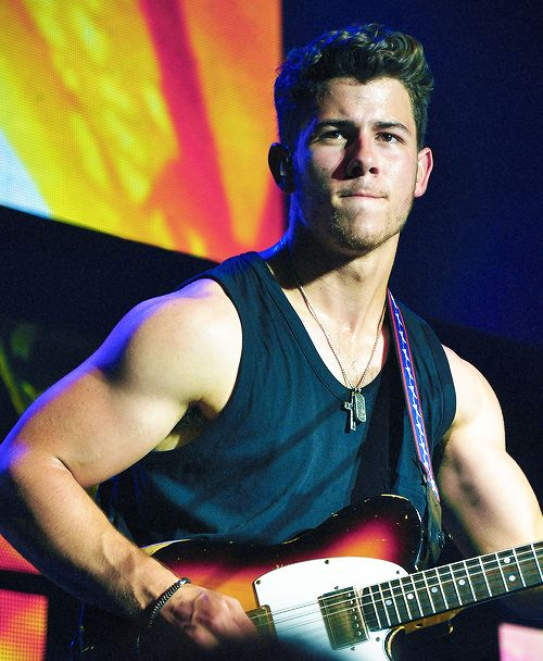 Nick Jonas. He is so cute and always so serious...which makes him so much cuter lol oh and he's a beast at playing guitar BONUS!