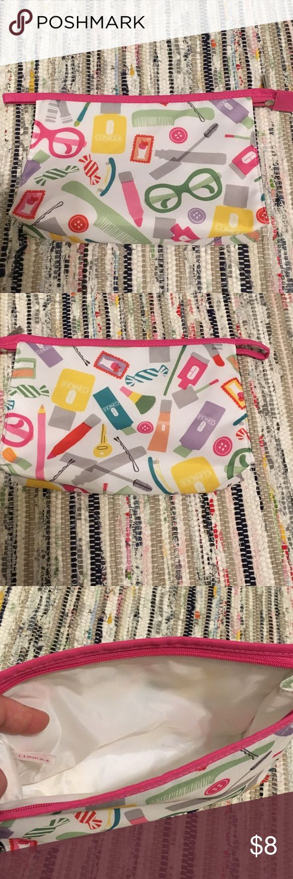 Clinique make up bag Never used! Clean inside 9in across 6 inches length Clinique Bags Cosmetic Bags & Cases