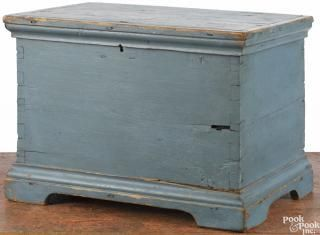 Miniature painted pine blanket chest, 19th c., retaining an old blue surface, 13 1/2'' h.