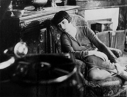 Louise Brooks listening to records.