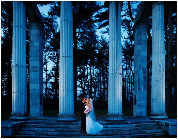 For a maternity shoot, I'd try doing a nature shoot instead of this. Instead of columns, I'd light the trees this way. The woman would be alone and standing right at the centre, illuminated, to create a goddess of natrure kind-of effect.    (Strobist: Ryan Brenizer's Panoramic Portraiture)