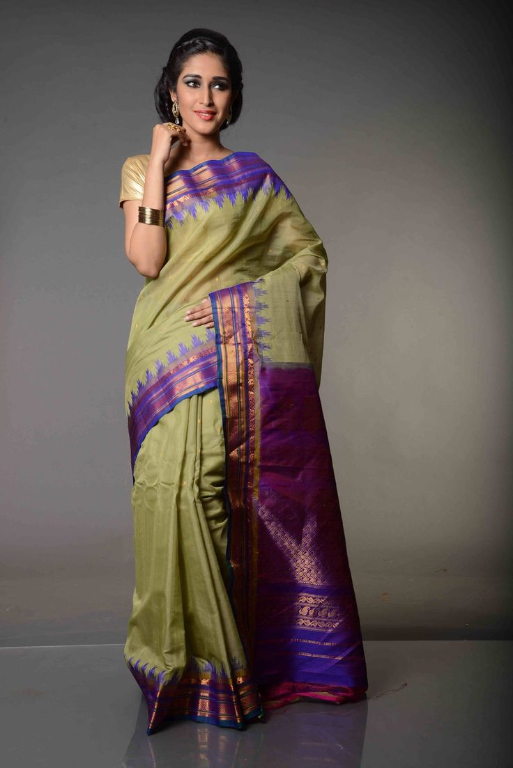 Mridula Soft and Sensuous Gadwal Silk Cotton Saree : In a soft pastel shade only to be contrasted with bright purple, Mridula Soft and Sensuous Gadwal Silk Cotton Saree is pragmatic and earnest. Woven around the themes of soft Gadwal Sarees, it makes a soothing wear for hot and sunny days.