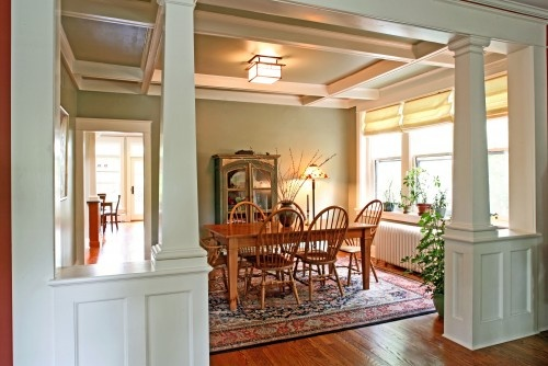 The architectural details add interest to the room while the open windows and large doorway keep the room from becoming too formal.