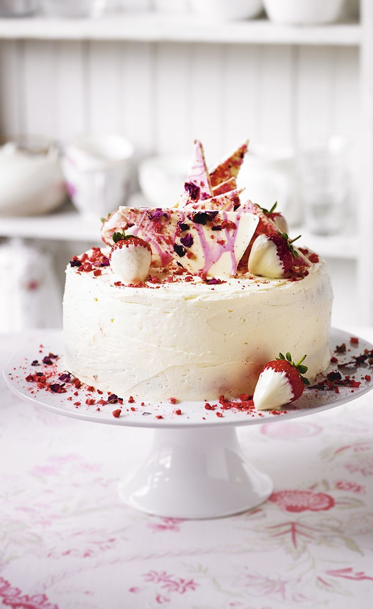 Martha Collison's Strawberry, Champagne, Rose Layer Cake crowned with shards of white chocolate and dipped strawberries. Find the full recipe on the Waitrose website.