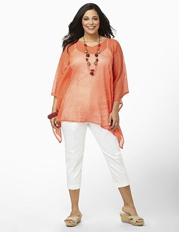 For a breezy, lightweight layer, slip this poncho-style blouse over your tanks and tees. Goldtone dots glow along the sheer fabric. V-neck style is complete with a raised, fabric design for a textured finish. Catherines accessories are customized in size and scale for the plus size woman. catherines.com