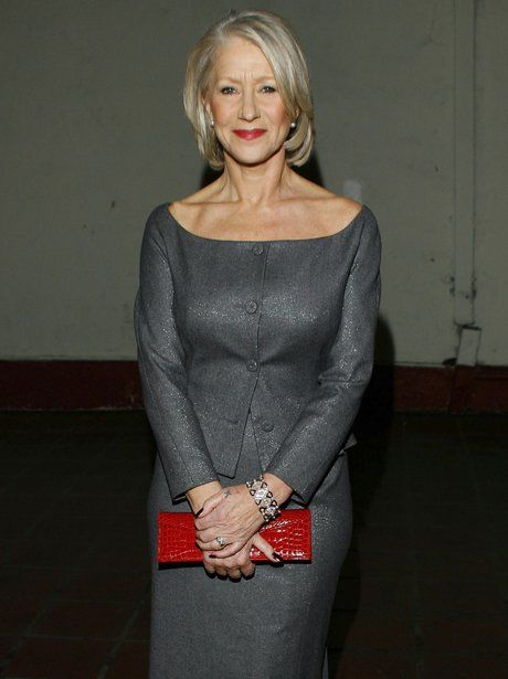 Helen Mirren shows off her flawless décolletage in this scoop neck grey dress in 2007.