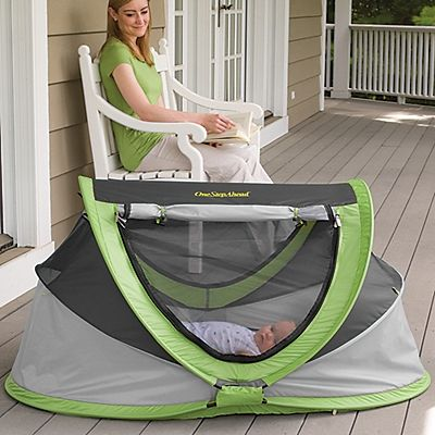 Our Exclusive!  Bye-bye, hard, bulky play yards—we'll take our comfortable, portable, soft cocoon of a baby travel bed instead!
