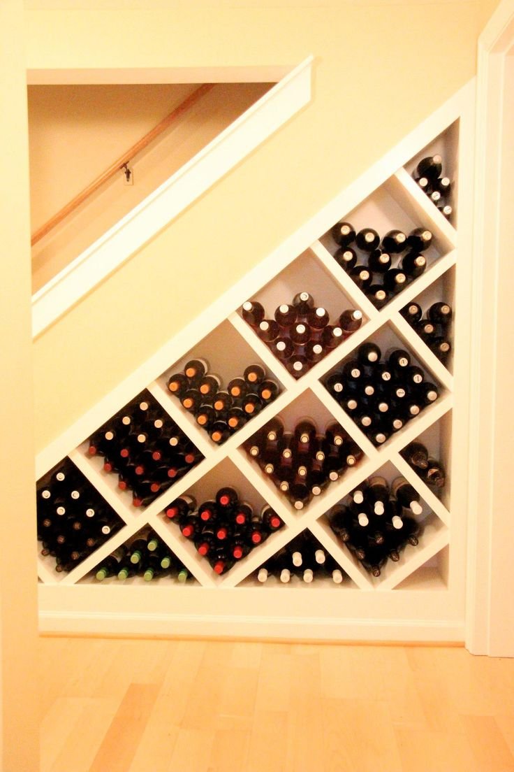 Basement Remodel: Great use of space - under the stairs wine storage www.theworkspdx.com