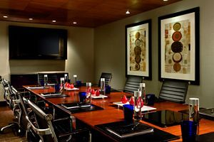 Boardroom-style meeting room with expansive table, comfortable chairs and audiovisual facilities | CA 90015