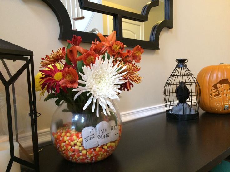 Halloween candy corn and peeps tombstone floral arrangement.
