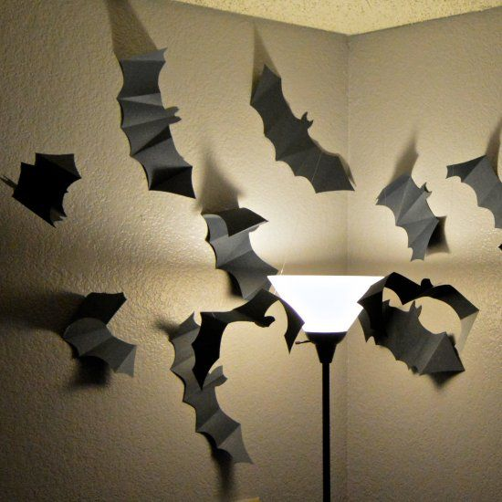 Step up your Halloween decor with a paper bat swarm! They will give your home a spooky feel with shadows on the wall.