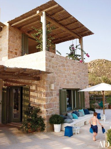 Architect Dimitri Konstantinidis designed the house, using local stone | archdigest.com