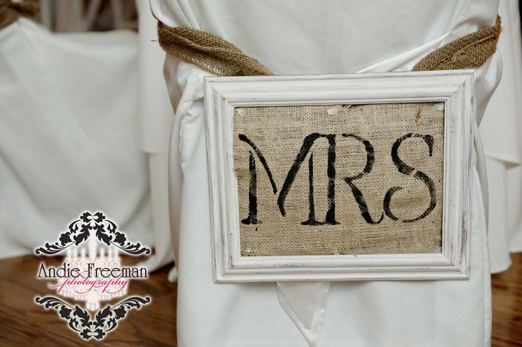 Mr. and Mrs. sign down with burlap in white frame.  Classic Shabby Chic Fall Wedding. Photography: Andie Freeman Photography www.TheAthensWeddingPhotographer.com Wedding Planning and Coordinating: www.WildflowerEventServices.com Venue and Floral: The Thompson House and Gardens
