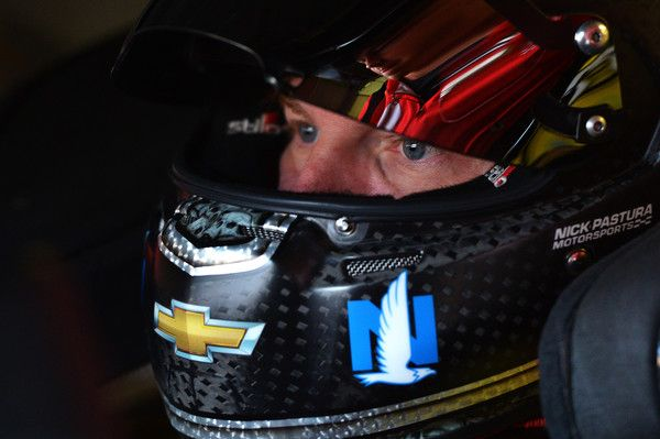 Dale Earnhardt Jr. Photos - Dale Earnhardt Jr, driver of the #88 Axalta Chevrolet, sits in his car during practice for the NASCAR Sprint Cup Series FireKeepers Casino 400 at Michigan International Speedway on June 11, 2016 in Brooklyn, Michigan. - Michigan International Speedway - Day 2