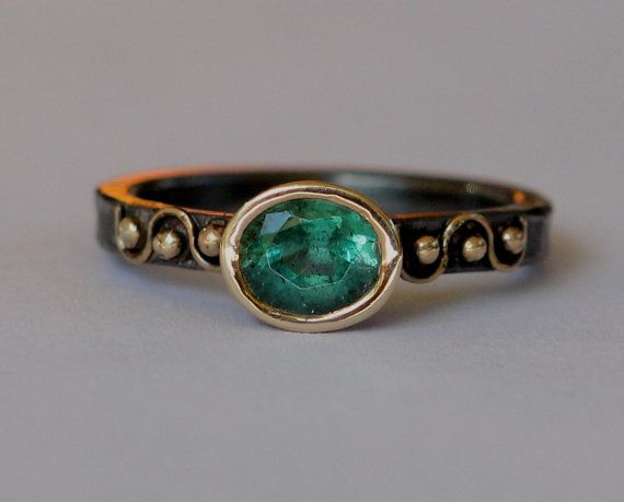 Size 6.5 hammer forged sterling silver ring. The stone is a high quality natural .88 ct medium green Columbian emerald (panna stone). The band is