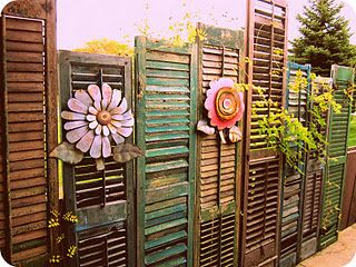 Privacy fence made of assortd old shutters. #privacyfenceidea #repurposed #diy