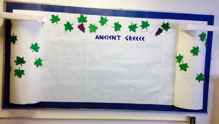Ancient Greece Bulletin Board inspired by another pinner! White butcher paper for the background and columns, green leaf die cuts, and purple construction paper grapes.