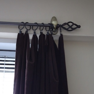 A 3M Command Hook to hold up curtain rod. Perfect when you cant drill holes in a rental or dorm!