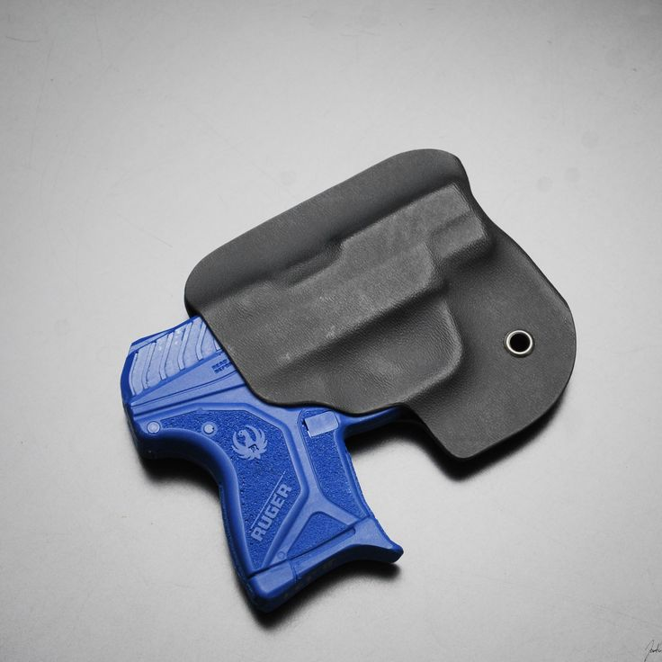 Ambidextrous concealed pocket or purse carry for the Ruger LCP II. With a tight grip to avoid accidental release. Made with 0.060 Black Kydex, and riveted with an eyelet to maintain tension. THIS WILL