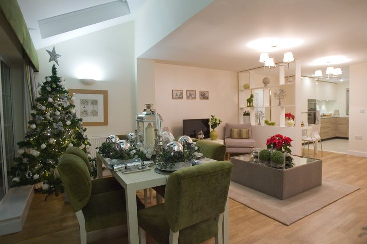 The Christmas decorations in this show home at The Lanes, Broadbridge Heath blend perfectly with the room. The oversized baubles make inventive and effective place holders and the poinsettias inject festive cheer.
