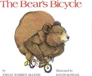A young boy and an outrageous bear demonstrate how to ride a bicycle safely.