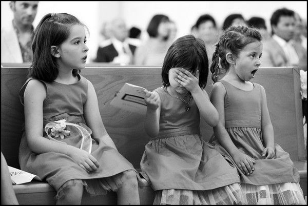 Little girls reactions to the  kiss at a wedding.