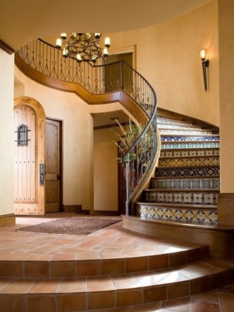Spanish tile stair risers. Handmade tiles can be colour coordinated and customized re. shape, texture, pattern, etc. by ceramic design studios