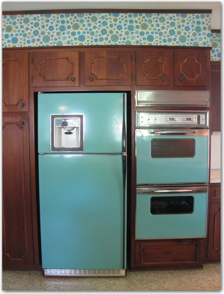 turquoise appliances and Vera Bradley-esque wallpaper.