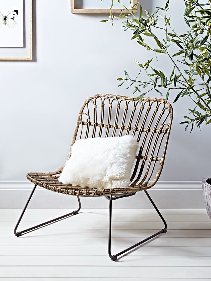 Carefully woven from beautiful rattan around an iron frame, our low chair has a wide seat for extra comfort and high back. Perfect for additional casual lounging in your living space, this large, low chair is comfortable and stylish too.