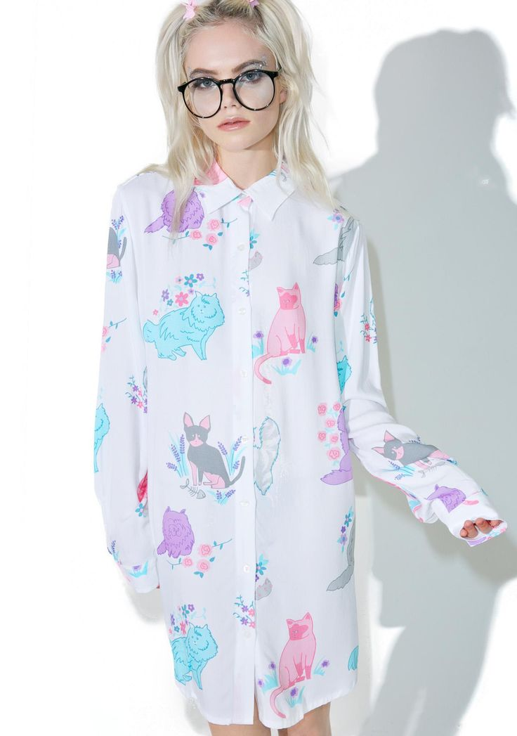 Lazy Oaf Garden Cats Shirt gotta pet 'em all, bb! Scratches 'N hisses don't bother a cat whisperer like yew, so hop into this ultra adorable shirt, featurin' a swingy and flowy white construction, pointed collar, slight high-low cut, slouchy sleeves, tonz of pastel kitten 'N flower graphics all over, and full length button front closure.