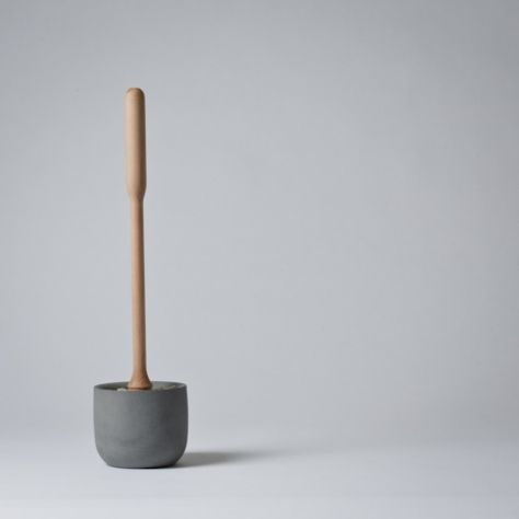 Concrete toilet brush  http://store.mjolk.ca/Inventory.html  75.00 bucks  A toilet brush set designed by Lovisa Wattman.    The bowl is made from a very smooth concrete, and the brush is made from birch wood with natural tampico bristles.    H41cm x W11cm    Made in Sweden.
