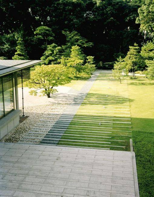 It's a cool look, not sure how comfortable I would feel hanging out in this space though.  grass and paving interweaving