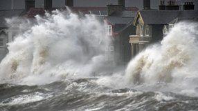 Waves crash against the promenade wall in Prestwick, Scotland 10/12/14