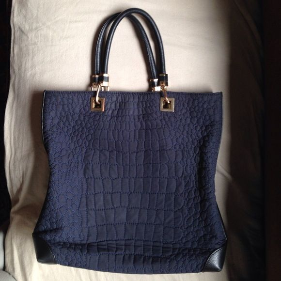REISS quilted and leather tote bag. Chic, stylish & useful tote bag from a favorite store of Kate Middleton! Navy quilting, gold hardware and black leather details. Perfect condition but for slight discoloring on some hardware. Snap on top and inside 2 pockets and zipper compartment. Great for work or to elevate jeans & t-shirt! Reiss Bags Totes