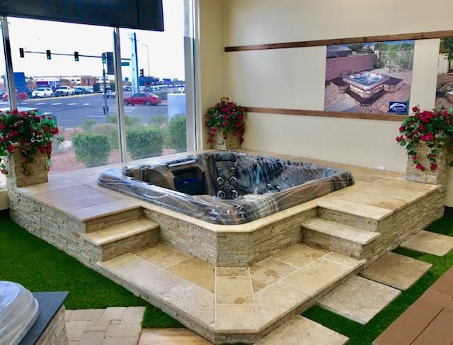 Semi In Ground Hot Tub Featuring High End Travertine Tile In The