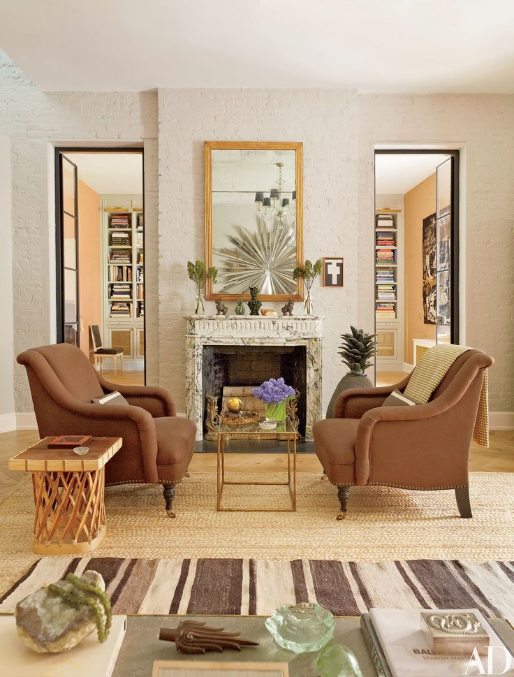Nice Metal And Glass Doors And A 19th Century Mantel Enhance The Living Room Home Design Ideas