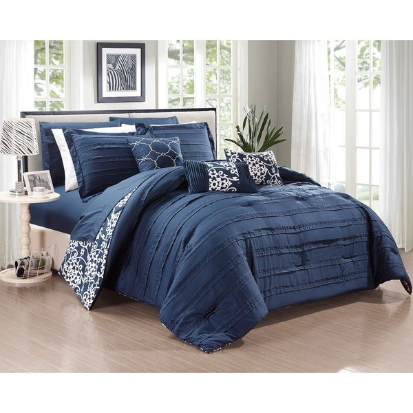 Crafted from supersoft microfiber brushed fabric, this bedding ensemble allows you to have a very romantic pinch pleated look one side with contrast color details as it reverses into a modern geometri