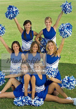 youth cheer Poses | Cheerleaders posing on lawn, (portrait) Stock Photo - Premium Royalty ...