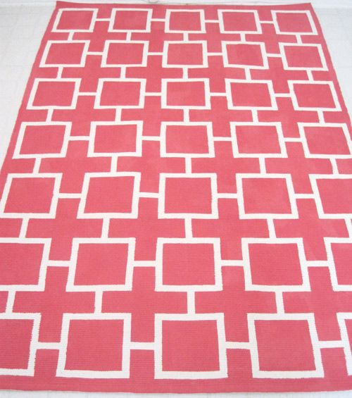 DIY painted geometric rug. Start with Ikea rug, tape a border and design, then paint with latex paint + fabric medium. $60 for rug and supplies.