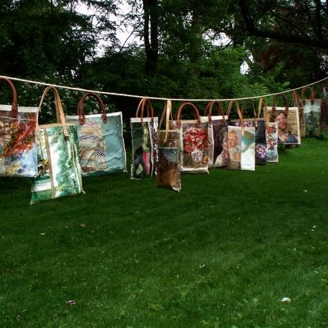 I am in LOVE with this idea! Taking old paintings and repurposing them into beautiful bags.
