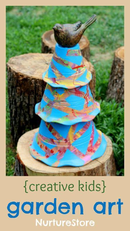 a gorgeous toddler craft: tape-resist clay pot garden sculpture.