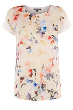 This printed jersey tee is constructed from a soft jersey with woven panel front and features a round neck, short sleeves a watercolour print design. Length of top, from shoulder seam to hem, 65cm approx. Height of model shown: 5ft 10 inches/178cm. Model wears: UK size 10Fabric:Main: 100.0% Viscose.  Woven: 100.0% Polyester.Wash care:Machine WashProduct code: 02353499 £26.00