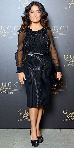 Salma Hayek in a Gucci sheer-sleeve, shimmering dress and Sergio Rossi pumps