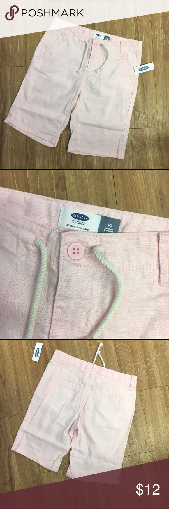 """NEW NWT Old Navy Linen Midi Shorts Pink Girls 10 NEW NWT Old Navy Linen Midi Shorts Pink Girls 10  Label says """"peach carnation"""" but these are freakin' pale pink.  LOL.  Belt loops, adjustable waist, nonfunctional drawstring.  Back pockets are faux but front pockets are functional.  #new #nwt #shorts #pink #palepink #midi #peachcarnation #linen #linenshorts #preppy #modest #longerlength Old Navy Bottoms Shorts"""