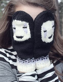 "Mittens inspired by ""Spirited Aways"" No-Face. They feature No-Face's mask on the top portion of the mitten and then plain black on the other side. This is done with intarsia in the round. There is stranded colorwork on the cuff as well. His face is added later with mock stitches."