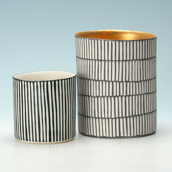 Cylinders, one with gold interior, Lara Scobie