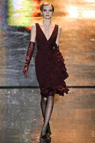 Badgley Mischka Fall 2011 Ready To Wear. A very vintage feel. Love the multitude of ruffles and those red leather gloves.