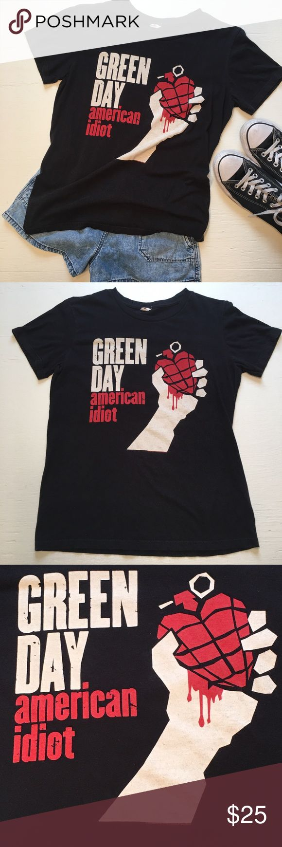 Green Day American Idiot Album Cover T-shirt The band Green Day American Idiot Album Cover graphics tee. Perfect for that #1 fan!!! Adult size XS.   *No trades or try on's. *Smoke free home. *Only the shirt is for sale, additional clothing & props are not included with purchase.  Please feel free to ask me any ?s & be sure to bundle all your likes for an AH-mazing deal!!! F132 Green Day Tops Tees - Short Sleeve